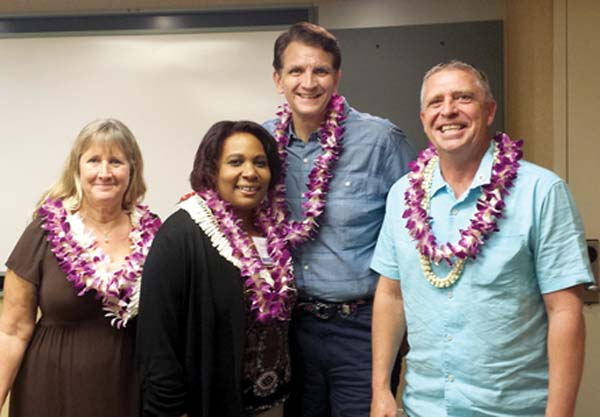Andrea Hall Rodgers (from left), Bevanne Bowers, Rob Lane and Paul Tonnessen have successfully completed all required coursework and have been inducted as Weinberg Fellows.