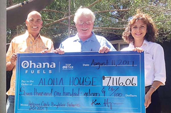 Hawaii Petroleum President Kimo Haynes (from left), Aloha House CEO Jud Cunningham and Hawaii Petroleum Marketing Representative Laura Alfonso are shown at Aloha House's Residential Treatment Program campus in Makawao.