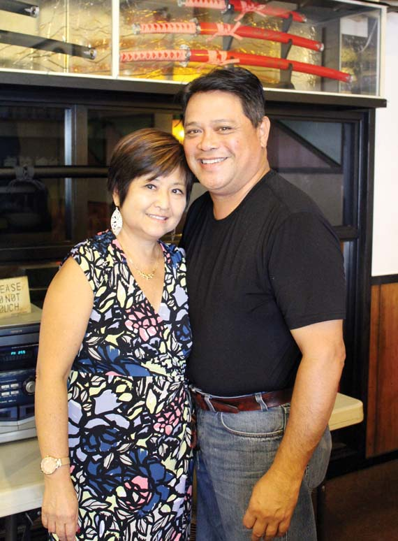 "Margie and Tom Albete will ""throw in the towel,"" so to speak with Saturday being the last day of business at the 49-year-old Archie's Restaurant. -- The Maui News / CARLA TRACY photo"
