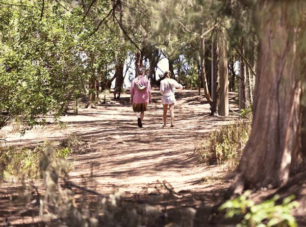 A couple walks on a path that was bordered by tents and campsites before this year's cleanup. -- The Maui News / MATTHEW THAYER photo