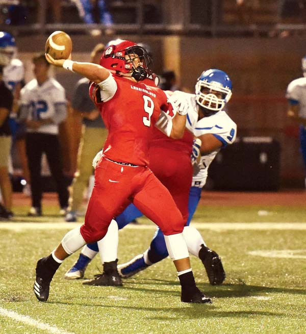 Lunas quarterback Nainoa Irish passes in the second quarter.  -- The Maui News / MATTHEW THAYER photo