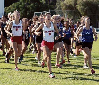 Seabury Hall's Veronica Winham heads to the front at the start of Saturday's Seabury Hall Invitational. -- The Maui News / CHRIS SUGIDONO photo