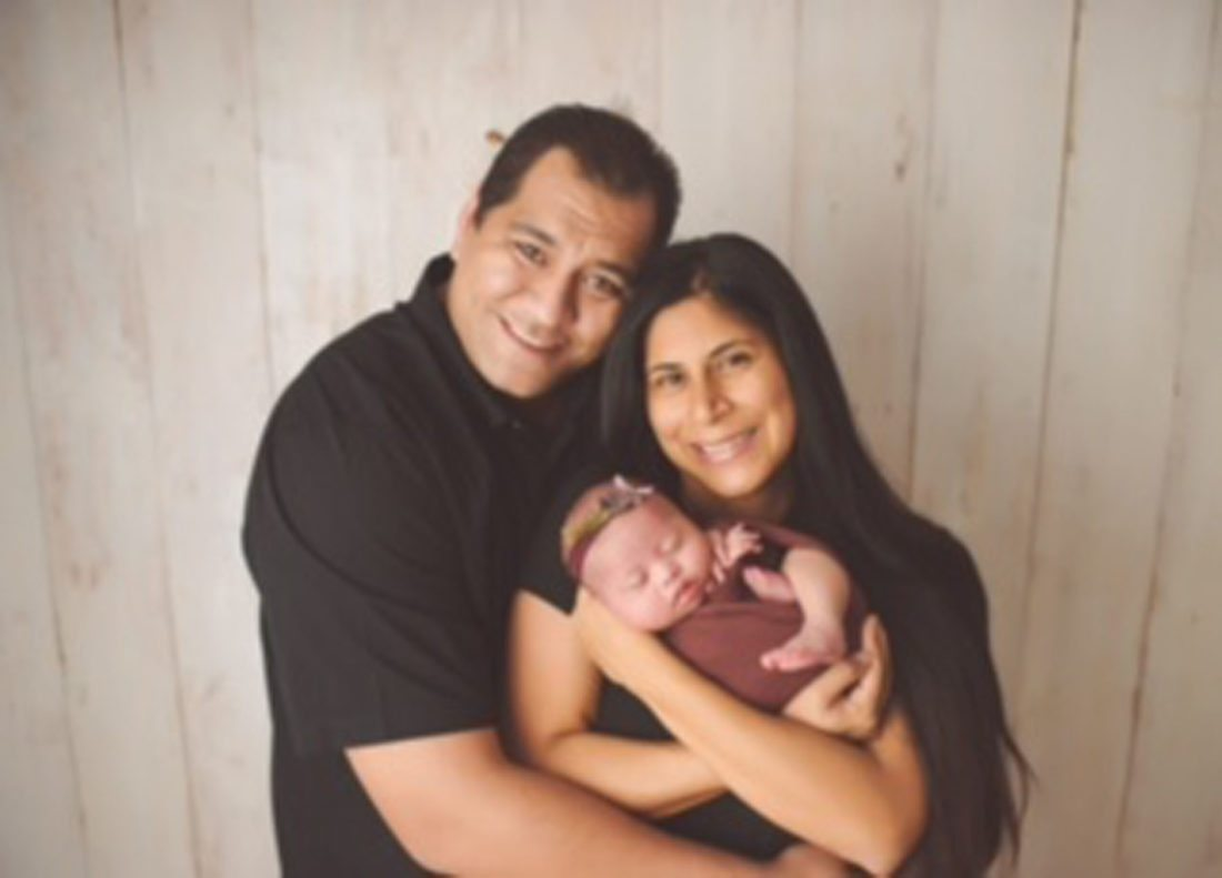 Elias and Stephanie Garcia pose for a newborn photo with their daughter, Elianna. The Pukalani infant, who was born in March, is featured in the National Down Syndrome Society's annual video. • KRISTY COPPERFIELD photo