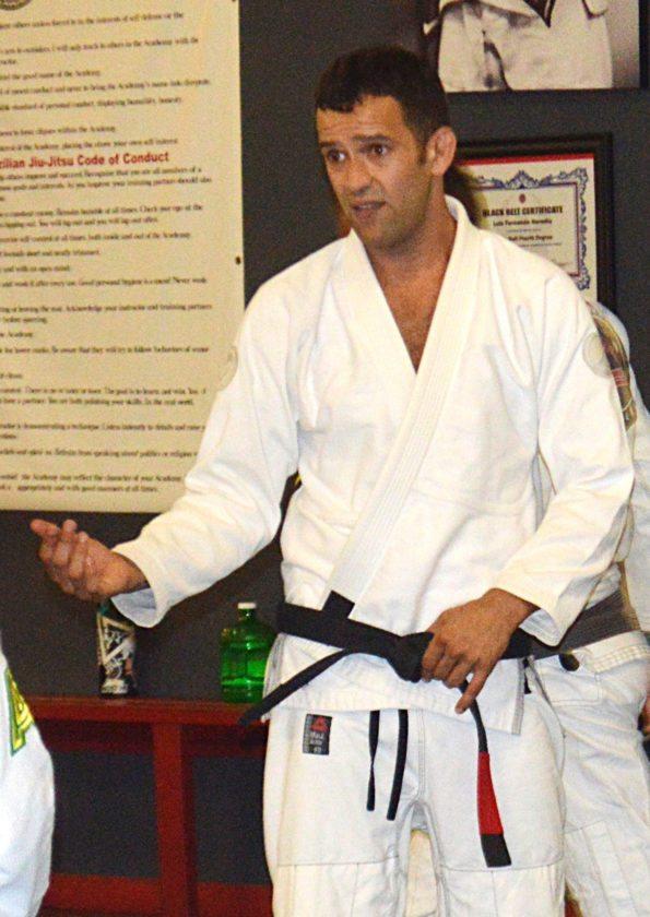 Maui Jiu Jitsu Academy instructor Joel Bouhey gives instruction during a white-belt class last week. • The Maui News / BRAD SHERMAN photo