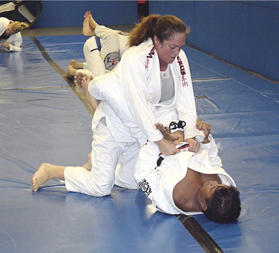 Moxie Dubois and Edwin Santos practice a technique during a Maui Jiu Jitsu Academy class last week. • The Maui News / BRAD SHERMAN photo