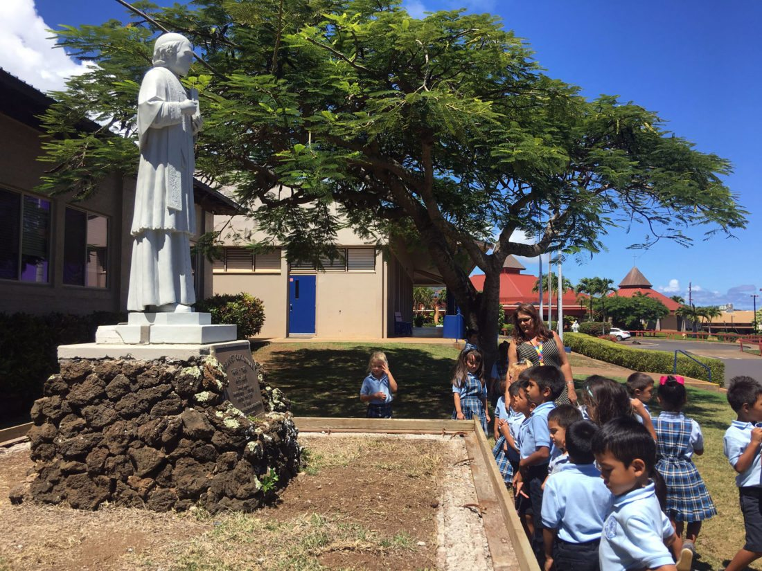 Led by St. Anthony School teacher Teri Tavares, kindergartners visit the site of newly erected statue of the BlessedWilliam Joseph Chaminade on the school's upper campus in Wailuku. • St. Anthony School Maui photo
