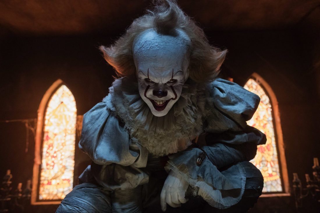 """Bill Skarsgard (above) embodies the role of Pennywise in the big screen version of """"IT."""" • Warner Bros. Pictures via AP photo"""