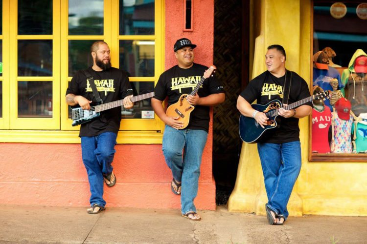 TODAY – Kimo Brehm (from left), Marvin Tevaga and Kalani Miles, known as Matagi, perform a free Hawaiian music concert at the Baldwin Home Museum; photo provided courtesy Lahaina Restoration Foundation.