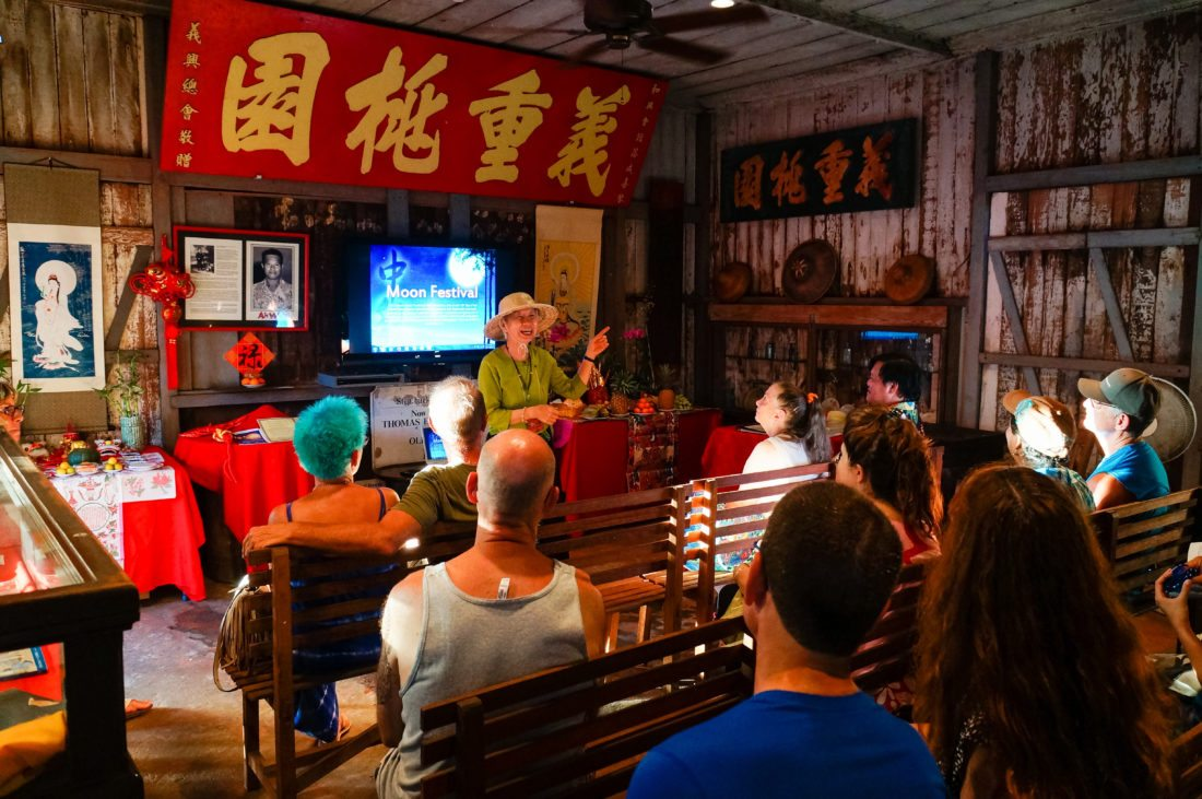 Wo Hing Cultural Director Busaba Yip talks about the history of Chinese Moon Festivals inside the old cookhouse; photo provided courtesy Lahaina Restoration Foundation.