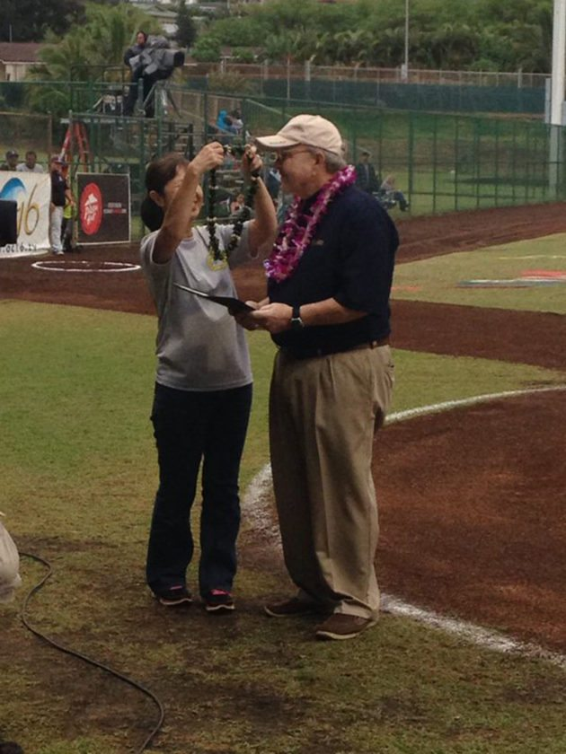 Fred Davidson is presented with a lei by Masayo Sutton while being honored during the state high school baseball tournament on May 7, 2016. • The Maui News / ROBERT COLLIAS photo