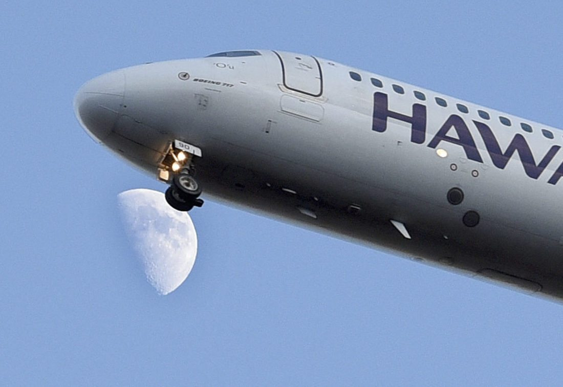 A Hawaiian Airlines jet passes in front of the moon Thursday evening on its final approach to Kahului Airport. Visitor arrivals to Maui island were up 2.5 percent to 233,266 in August, compared with August 2016, according to the Hawai'i Tourism Authority. Visitor spending and arrivals were down significantly in August for Molokai and Lanai. • The Maui News / MATTHEW THAYER photo