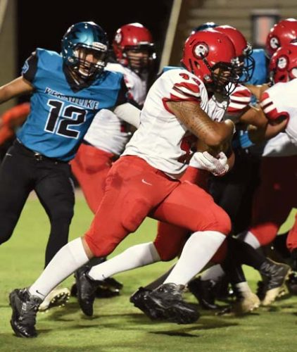 Lahainaluna High School's T.J. Galoia runs for a touchdown in the first quarter of the Lunas' 52-0 win over King Kekaulike on Friday at War Memorial Stadium. -- The Maui News / MATTHEW THAYERphoto