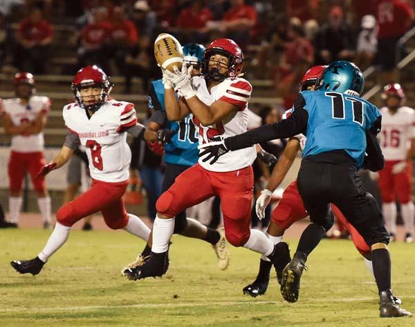 Lahainaluna's Jesse Dudoit intercepts a first-quarter pass in front of King Kekaulike's Arik Mendoza. -- The Maui News / MATTHEW THAYERphoto