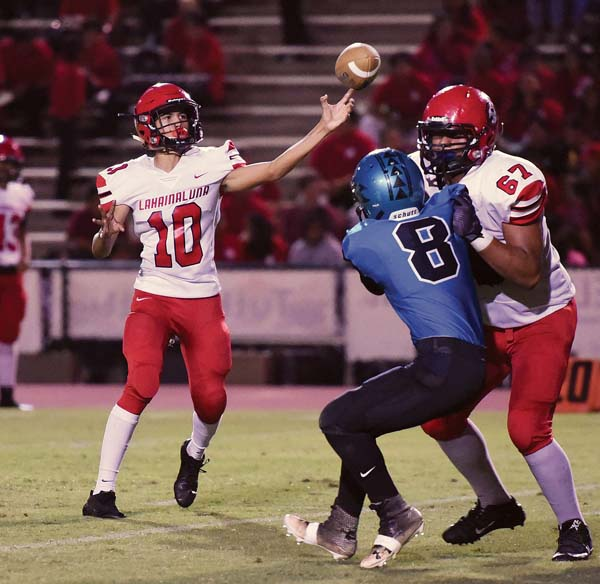 Lahainaluna's Kamahao Acpal releases a first-quarter pass as Pablo Rico blocks Isaac Ibarra. -- The Maui News / MATTHEW THAYER photo