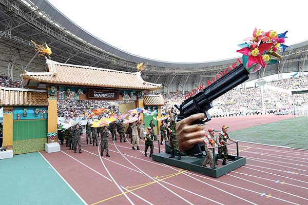 "With a banner that read ""Last destination of peace, Pyongyang!,"" a festival parade train resembling an old Dorasan station was cheered on by thousands across the packed Hwaseong Sports Complex stadium in Gyeonggi Province, South Korea."