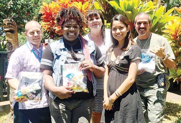 Aloha House Residential Treatment Program Director Tony Arcuria (from left), Care House youth Marcus Coney, Care House President Leah Blankenship, Care House youth Maria Baptiste and Aloha House Substance Abuse Counselor Nicodemus Baca are shown at the Aloha House campus with some of the care packages that were presented to clients.