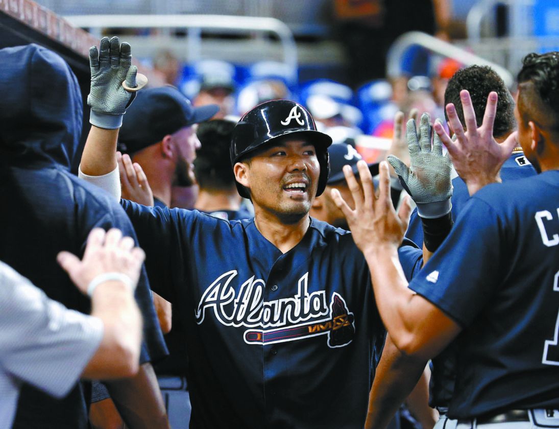Kurt Suzuki is congratulated in the Atlanta Braves dugout after homering in the third inning of an 8-5 win over the Miami Marlins on Sunday. • AP photo
