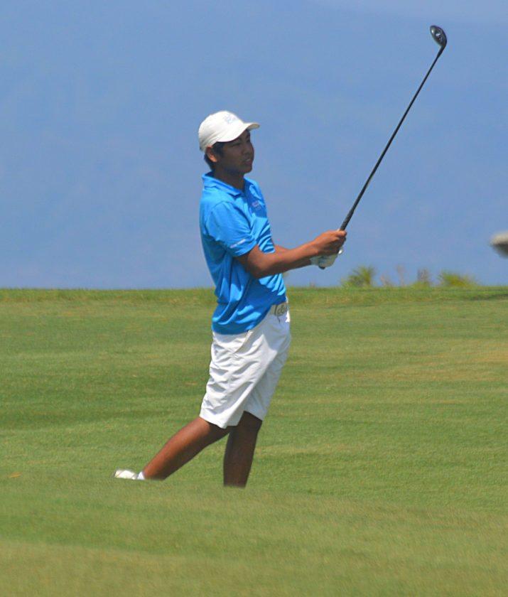 A.J. Teraoka watches a shot on the first hole. • The Maui News / ROBERT COLLIAS photo