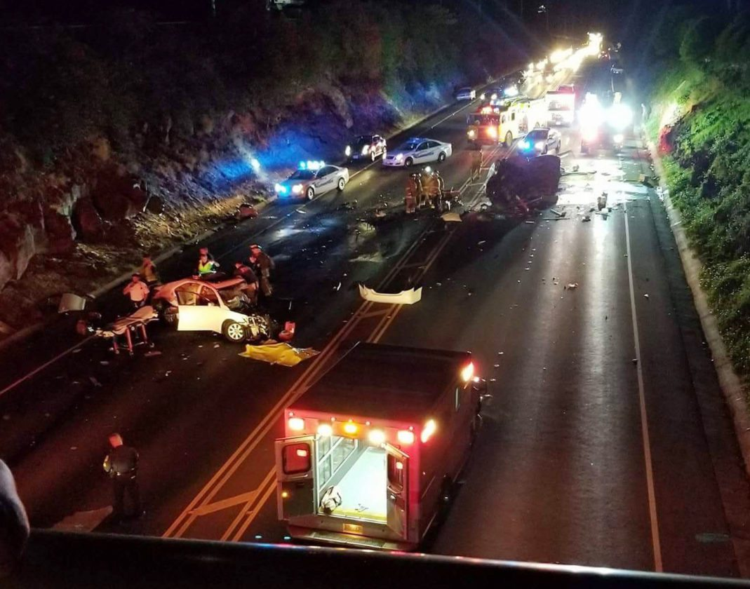 First responders tend to victims of a fatal four-vehicle crash on Honoapiilani Highway in Kaanapali on Saturday night. • ALI VOGELE photo