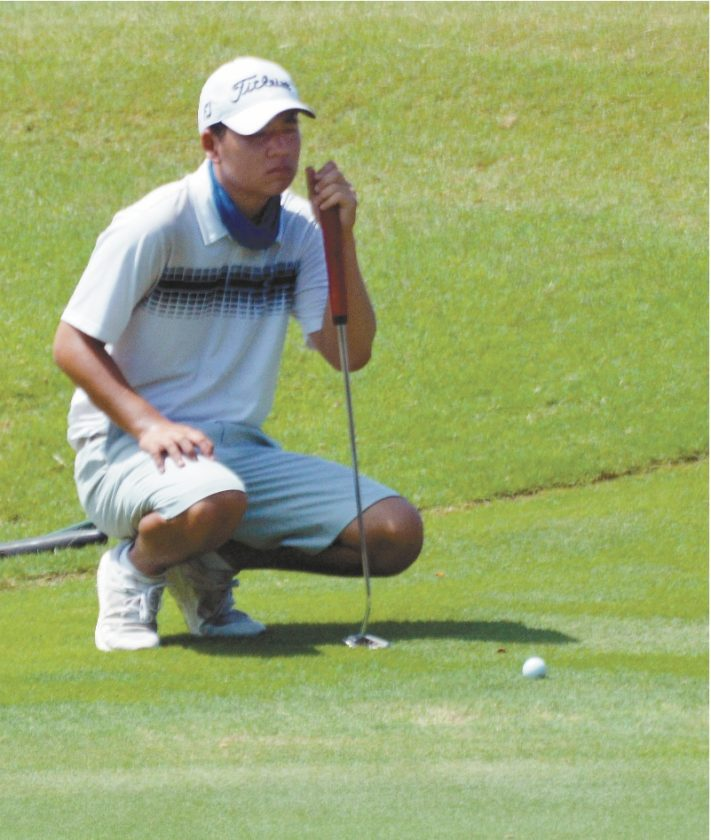 PHOTO BELOW: Jordan Terada lines up a putt from just off the 18th green. • The Maui News / ROBERT COLLIAS photo
