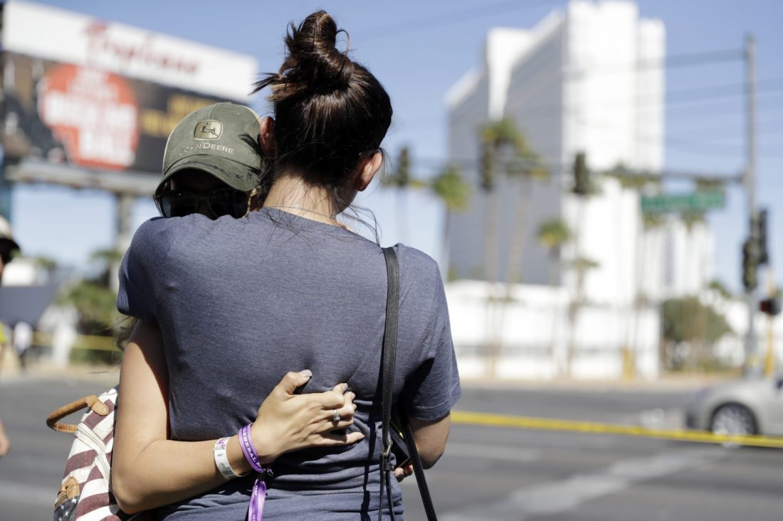 Ventura, Calif., residents Aria James and Jenna Kerr embrace Monday on the Las Vegas Strip near the concert venue where a mass shooting occurred in Sunday night. Both attended the concert. •AP photo