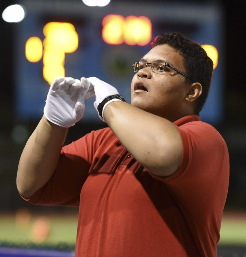 Lahainaluna Drum Major Isikeli Tafea leads his musicians in a first-half song Friday. He is one of three drum majors in the Lunas' band. • The Maui News / MATTHEW THAYER photo