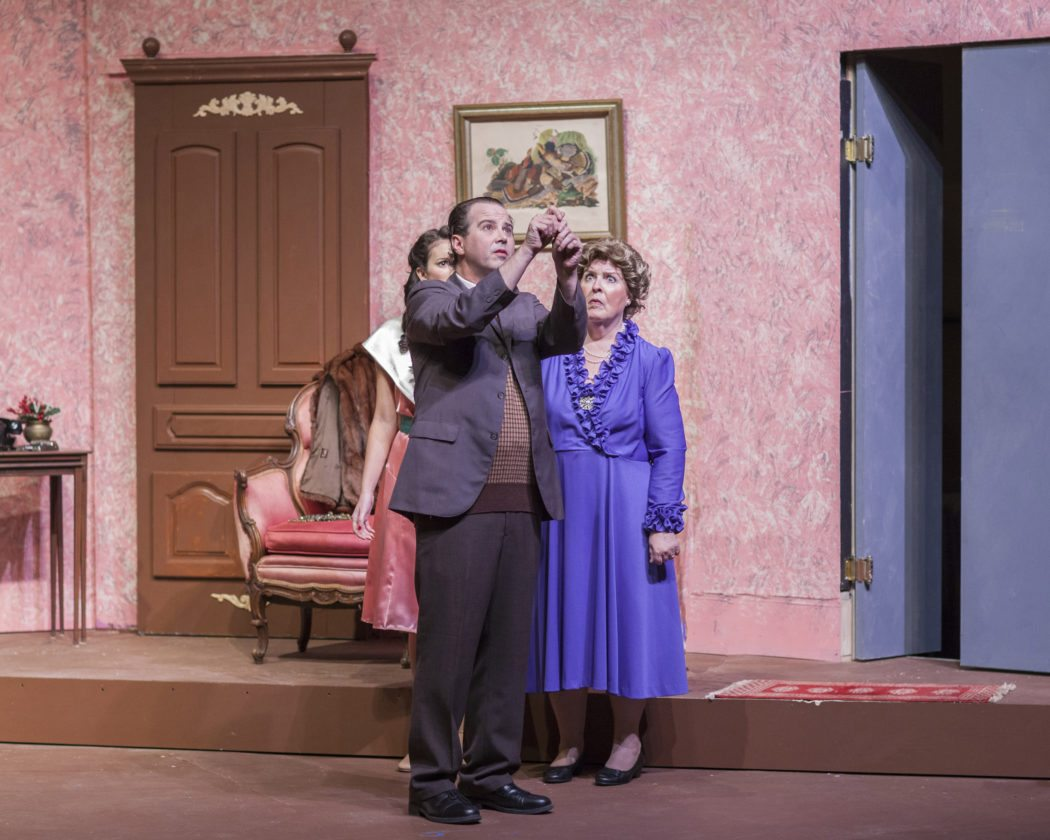 Elwood P. Dowd (Michael Pulliam) straightens the tie of his invisible friend, Harvey, as his sister Veta (at right, Beth Garrow), and niece, Myrtle Mae (Hana Valle), look on in disbelief. • Jack Grace Photo