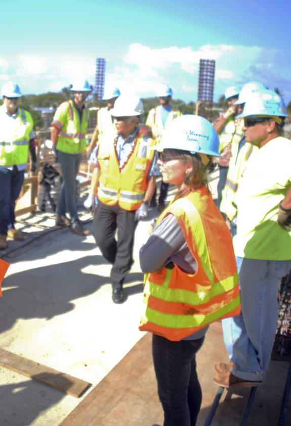 Gov. David Ige (center) inspects work on Kahului Airport's $340 million consolidated rental car facility Thursday afternoon while meeting with construction workers. • The Maui News / BRIAN PERRY photo