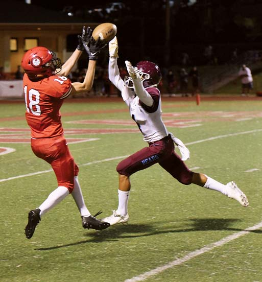 The Lunas' William Bookland catches a second-quarter touchdown pass as the Bears' Chase Mata defends. -- The Maui News / MATTHEW THAYER photo