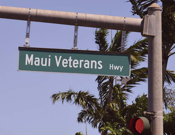 A new street sign at the intersection of the former Mokulele Highway and Hookele Street reflects the highway's name change. In April, Gov. David Ige signed a bill into law that changes the name of Mokulele Highway to Maui Veterans Highway. -- The Maui News / MATTHEW THAYER photo