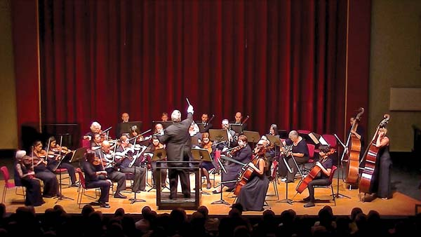 Maestro Robert E. Wills (back to camera) and the Maui Chamber Orchestra are riding a wave of success and reinvention. -- Photo courtesy Maui Chamber Orchestra