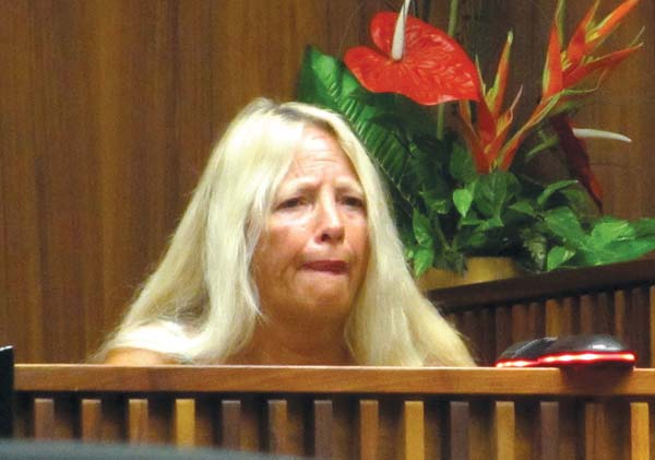 Deanna Bolen Nitta breaks down while testifying Tuesday about how her neck was cut during a gathering four years ago at a Lahaina apartment. She was a witness in the 2nd Circuit Court attempted murder trial of Calvin Borge. The Maui News / LILA FUJIMOTO photo