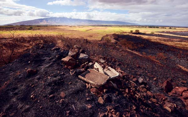 A set of fires that started in three different places and charred an estimated 100 acres was mostly under control Tuesday afternoon. The Maui News / MATTHEW THAYER photo