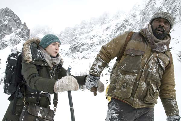 "Kate Winslet (left) and Idris Elba struggle to survive a plane crash in ""The Mountain Between Us."" • Twentieth Century Fox via AP photo"