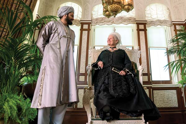 "Judi Dench (right) and Ali Fazal appear in a scene from ""Victoria and Abdul.""  • Focus Features via AP photo"