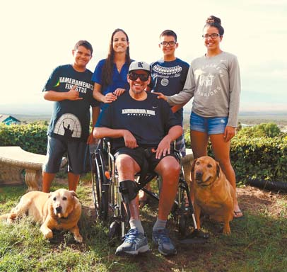 Former Kamehameha Schools Maui volleyball coach Bala Spencer, shown posing last week with his wife, Lisa (second from left), and children (from left) Pa'u, Kale and Logan, is recovering from a stroke suffered in November. The Maui News / CHRIS SUGIDONO photo