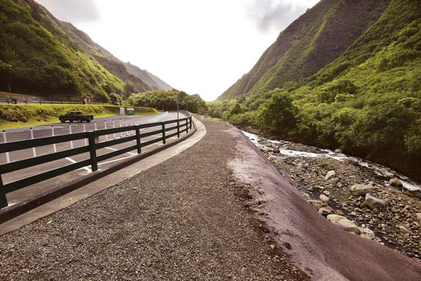The parking lot at Iao Valley State Monument is shown with improvements installed and a reinforced river bank just prior to the park reopening in August. A second phase of repair will close the park for about two months, opening again mid-December. -- The Maui News / MATTHEW THAYER photo