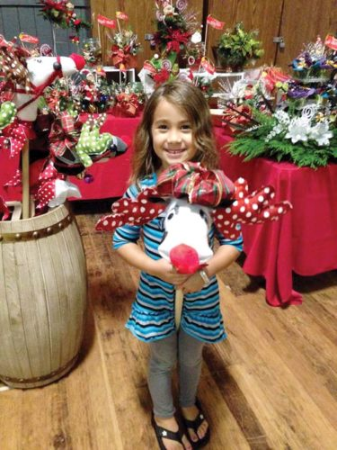 Neveah Howard plays with a stick reindeer. Old Town Projects' Karen's Christmas Crossing event on Nov. 18 in Haiku will feature holiday decor and handmade crafts. -- KAREN PERREIRA photo