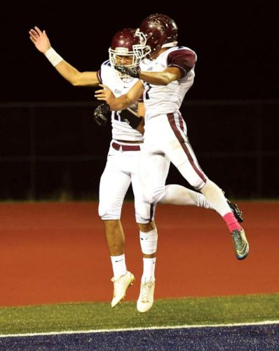 Baldwin High School's Chayce Akaka (left) and Kaikea Silva celebrate after Akaka scored on the return of a free kick after a safety in the first quarter of the Bears' 59-47 win over Kamehameha Maui on Saturday at Kanaiaupuni Stadium. -- The Maui News / MATTHEW THAYER photo