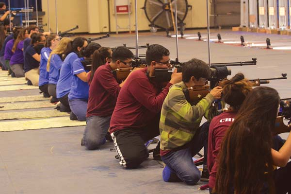 Air riflery competitors take part in the kneeling portion of Saturday's Maui Interscholastic League championship at Maui High School. -- The Maui News / BRAD SHERMAN photo