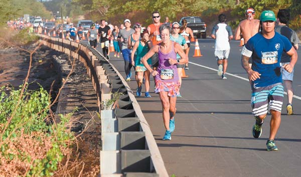 Half-marathon runners near the midpoint of the 13.1-mile course, which began and ended at the Kaanapali Beach Hotel. The Maui News / MATTHEW THAYER photo