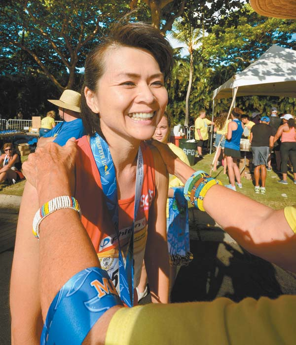 Yuko Nakai receives her medal after lifetime marathon win No. 11. The Maui News / MATTHEW THAYER photo