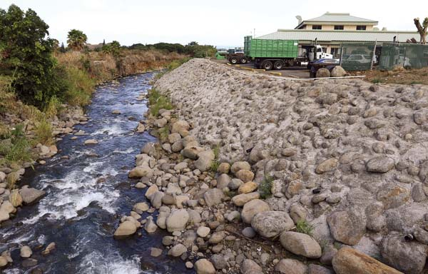 The Army Corps of Engineers plans to repair nearly 4,000 linear feet of damaged levees in Wailuku River. The Maui News / CHRIS SUGIDONO photo