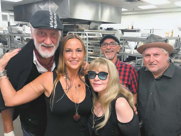Mick Fleetwood (from left), Gretchen Rhodes, Stevie Nicks, Lenny Castellanos and Ken Gieser enjoyed an evening together at Fleetwood's on Front St. in Lahaina last month. Pio Marasco photo