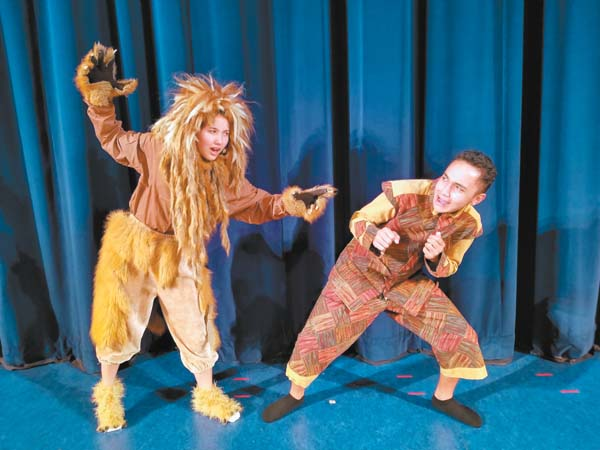 """Tatyum Herrick (left) and Maverick Akana in Kamehameha Schools Maui's production of Aesop's Fable, """"Androcles and the Lion."""" Camille Romero photo"""