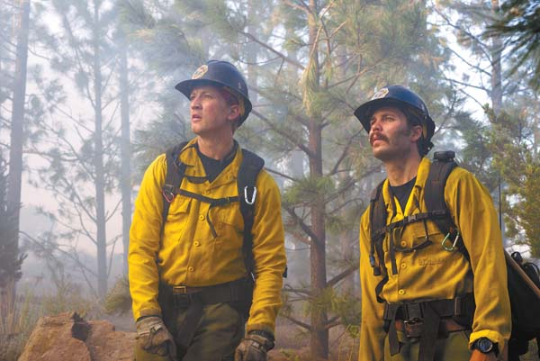 "Miles Teller (left) and Taylor Kitsch in a scene from ""Only the Brave."" Sony Pictures via AP"