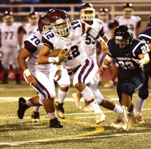 Chayce Akaka and the Baldwin High School football team faces Kainalu Tancayo (second photo) and Maui High on Friday at War Memorial Stadium. The Maui News / MATTHEW THAYER photos