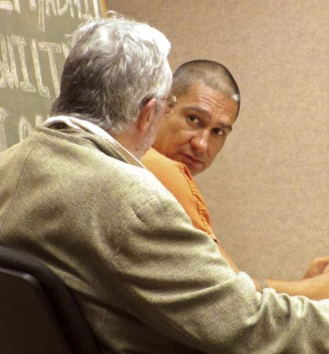 "James Burkhart talks with Deputy Public Defender William ""Pili"" McGrath during a preliminary hearing Thursday afternoon in Wailuku District Court. The Maui News / LILA FUJIMOTO photo"
