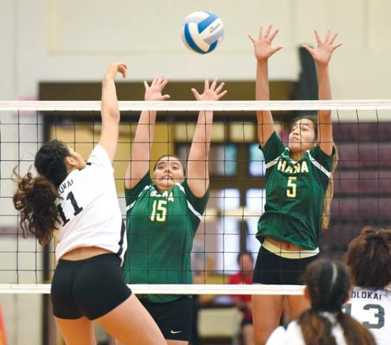 Hana High School's Shaylee Roback (center) and Nohokula Lind attempt to block a shot by Molokai's Taye Mowat during the second set of the Dragons' 25-18, 23-25, 25-20, 25-18 win over the Farmers on Thursday in a Maui Interscholastic League Division II tournament semifinal at Jon Garcia Gym. The Maui News / MATTHEW THAYER photo