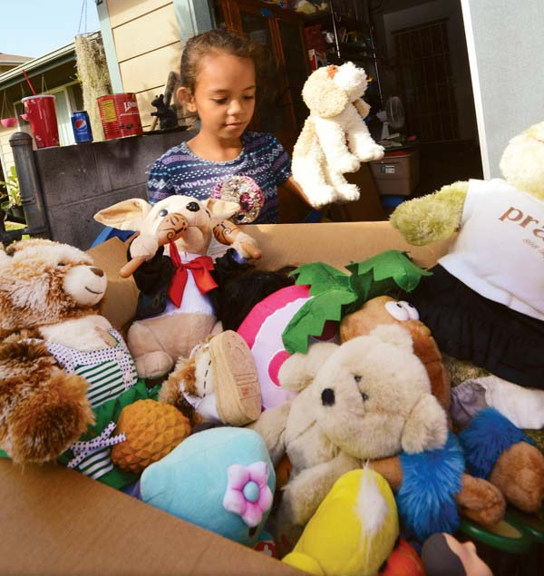 Waihee Elementary School 2nd-grader Hi'ilei DeFrancia-Uwekoolani, 7, helps pack a box of stuffed animals Thursday afternoon for children in Puerto Rico. The Maui News / MATTHEW THAYER photo